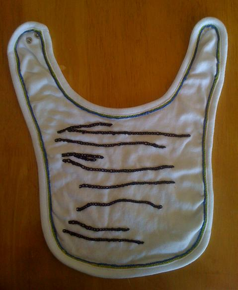 hand-embroidered baby bib with zebra stripes